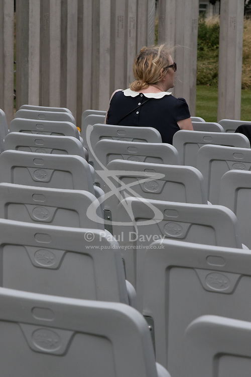 Hyde Park, London, July 7th 2015. Following closed ceremonies involving victim's families and survivors of 7/7, members of the public arrives to pay their respects at the Hyde Park memorial on the tenth anniversary of the bombings in which 57 Londoners were killed and scores injured.