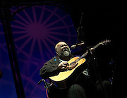 John Martyn <br /> performing 'Solid Air' live at <br /> The Roundhouse, Chalk Farm, London, Great Britain<br /> February 3rd, 2007<br /> <br /> John Martyn, OBE (11 September 1948 &ndash; 29 January 2009), born as Iain David McGeachy, was a British singer-songwriter and guitarist. Over a 40-year career, he released 21 studio albums, working with artists such as Eric Clapton, David Gilmour and Phil Collins. He was described by The Times as &quot;an electrifying guitarist and singer whose music blurred the boundaries between folk, jazz, rock and blues&quot;.<br /> <br /> John Martyn <br /> <br /> Photograph by Elliott Franks