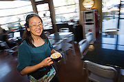 Owner Carole Rast delivers a latte at Roy's Station Coffee & Teas in Japantown of San Jose, California, on September 16, 2014. (Stan Olszewski/SOSKIphoto for Content Magazine)