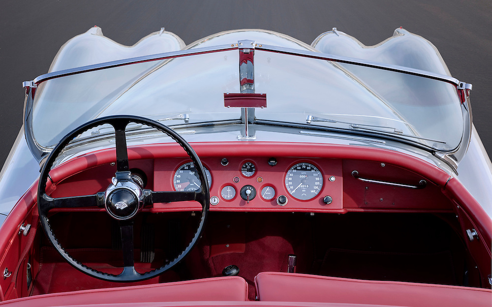 red interior of a silver 1954 Jaguar XK 120. photographed in the Desert of Palm Springs, CA