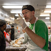 WASHINGTON, DC - OCT11:  Professor Christophe Fee at  D.C. Central Kitchen with his students and other volunteers, October, 11, 2014, to make meals for the homeless. As part of a literature of homeless course, Gettysburg College students volunteer in DC to learn about homelessness.  They will work in DC Central Kitchen, spend the night in a shelter, and blog about their experiences. (Photo by Evelyn Hockstein/For The Washington Post)