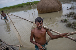 August 19, 2017 - Gaibandha, Bangladesh - A fisher man in a flood affected village is going for fishing in Gaibandha, Bangladesh. August 19, 2017.    Gaibandha is a district in Northern Bangladesh. It is a part of the Rangpur Division. Gaibandha is one of the districts of Bangladesh which got badly affected by recent flood mainly in the village areas. (Credit Image: © Turjoy Chowdhury/NurPhoto via ZUMA Press)