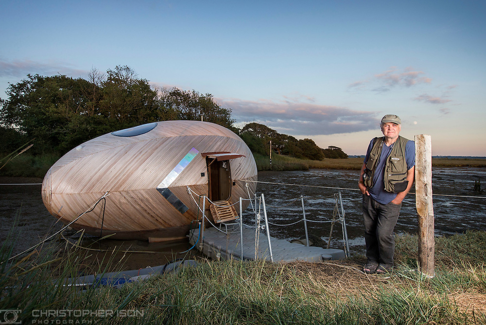 Artist Stephen Turner beside the Exbury Egg, his studio and occasional home on the bank of the Beaulieu River in the New Forest, Hampshire.