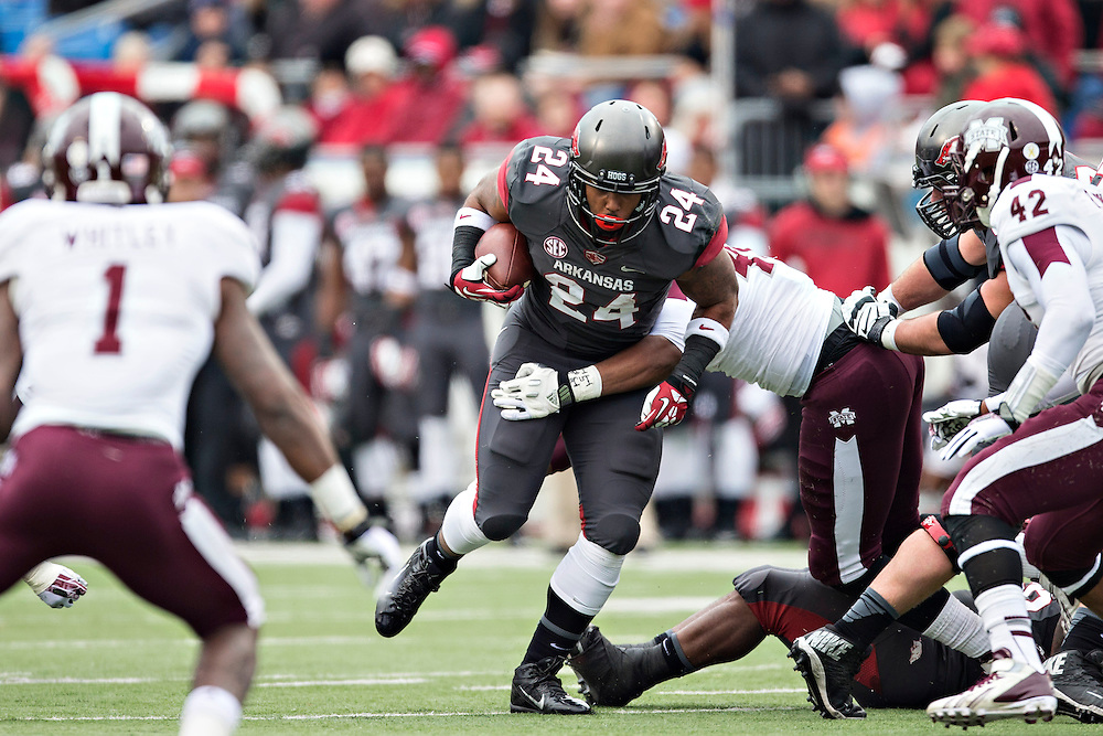 LITTLE ROCK, ARKANSAS - NOVEMBER 23:  Kody Walker #24 of the Arkansas Razorbacks runs the ball against the Mississippi State Bulldogs at War Memorial Stadium on November 23, 2013 in Little Rock, Arkansas.  The Bulldogs defeated the Razorbacks 24-17.  (Photo by Wesley Hitt/Getty Images) *** Local Caption *** Kody Walker