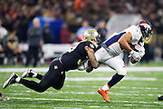 NEW ORLEANS, LA - NOVEMBER 13:  Devontae Booker #23 of the Denver Broncos is tackled by Kenny Vaccaro #32 of the New Orleans Saints at Mercedes-Benz Superdome on November 13, 2016 in New Orleans, Louisiana.  The Broncos defeated the Saints 25-23.  (Photo by Wesley Hitt/Getty Images) *** Local Caption *** Devontae Booker; Kenny Vaccaro