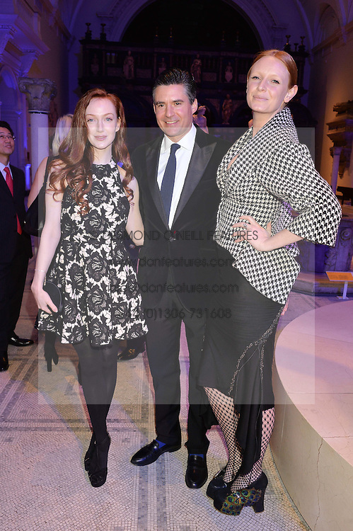 Left to right, OLIVIA GRANT, EDWARD TAYLOR and OLIVIA INGE at a private view of Alexander McQueen's Savage Beauty exhibition hosted by Samsung BlueHouse at the V&A, London on 30th March 2015.