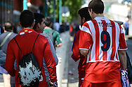General view of the exterior of the stadium showing an Atletico Madrid fan with a shirt bearing the name of current Chelsea and former Atletico Madrid player Fernando Torres pictured ahead of the UEFA Champions League Final at Estádio da Luz, Lisbon<br /> Picture by Ian Wadkins/Focus Images Ltd +44 7877 568959<br /> 24/05/2014
