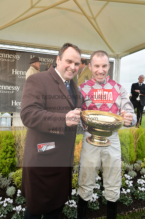 Left to right, ALAN KING trainer of Smad Place and WAYNE HUTCHINSON jockey of the 2015 Hennessy Gold Cup winner Smad Place at the 2015 Hennessy Gold Cup held at Newbury Racecourse, Berkshire on 28th November 2015.