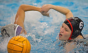 Lilly Bowers of Boston University races to grab the ball ahead of Elyse Kadokura playing for Massachusetts Institute of Technology.  Boston University won one of four matches at Saturday's women's preseason water polo tournament...Photo by Kate Samp