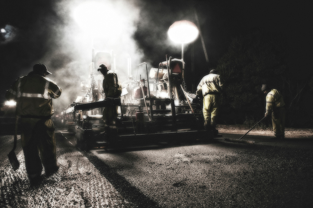 asphalt crew laying recycled rubber tire road on interstate highway 101 in northern california