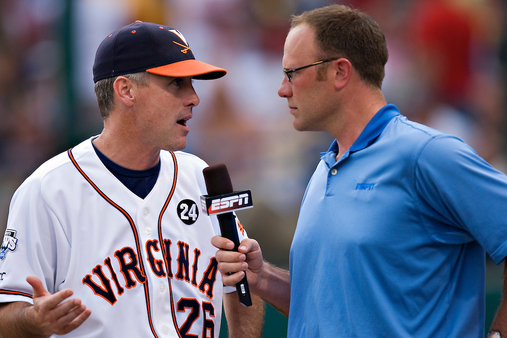 OMAHA, NE - JUNE 17:   Head Coach Brian O'Connor of the Virginia Cavaliers is interviewed by Kyle Peterson of ESPN during a game against the Arkansas Razorbacks at the College World Series on June 17, 2009 at Rosenblatt Stadium in Omaha, Nebraska.  Arkansas defeated Virginia 4 - 3 in 12 innings.  (Photo by Wesley Hitt/Getty Images) *** Local Caption *** Brian O'Connor; Kyle Peterson