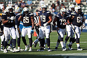 The Los Angeles Chargers offensive line breaks from the huddle and walks to the line of scrimmage during the 2017 NFL week 1 preseason football game against the Seattle Seahawks, Sunday, Aug. 13, 2017 in Carson, Calif. The Seahawks won the game 48-17. (©Paul Anthony Spinelli)