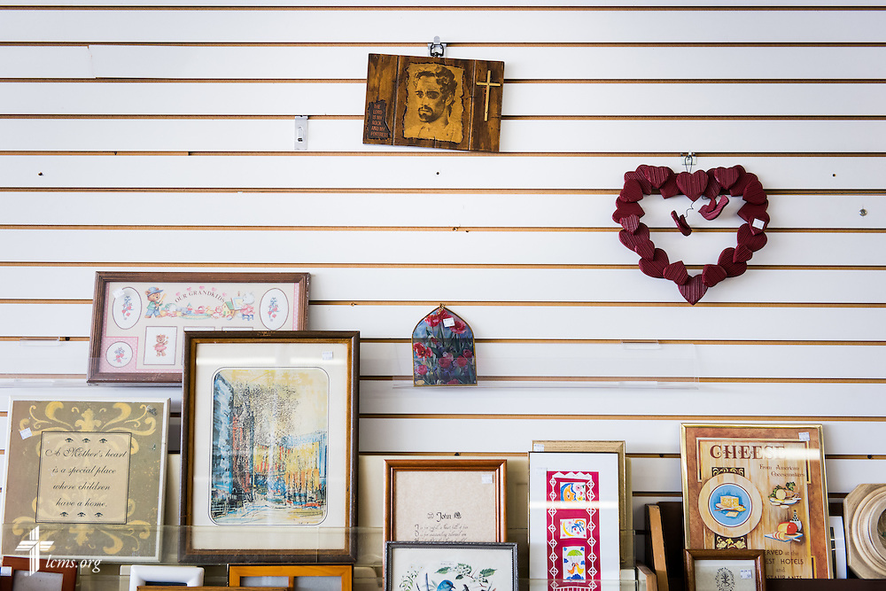 A small woodcut of a representation of Jesus hangs at Blessed Again Resale on Wednesday, Sept. 2, 2015,  in Milwaukee, Wis. The resale shop benefits A Place of Refuge maternity home. LCMS Communications/Erik M. Lunsford