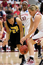 March 22, 2010; Stanford, CA, USA;  Iowa Hawkeyes forward Gabby Machado (50) and Stanford Cardinal forward Joslyn Tinkle (44) fight for a loose ball during the second half in the second round of the 2010 NCAA womens basketball tournament at Maples Pavilion. Stanford defeated Iowa 96-67.