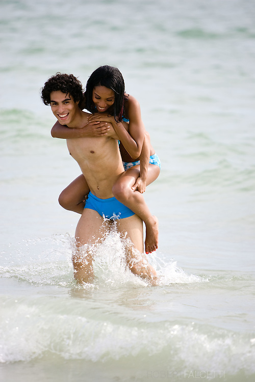 Johnny Castro, Lisa Alfred and Jaselie Jean Charlel enjoy Sand Key Park in Clearwater, Florida. 2009..©2009 RobertFalcetti