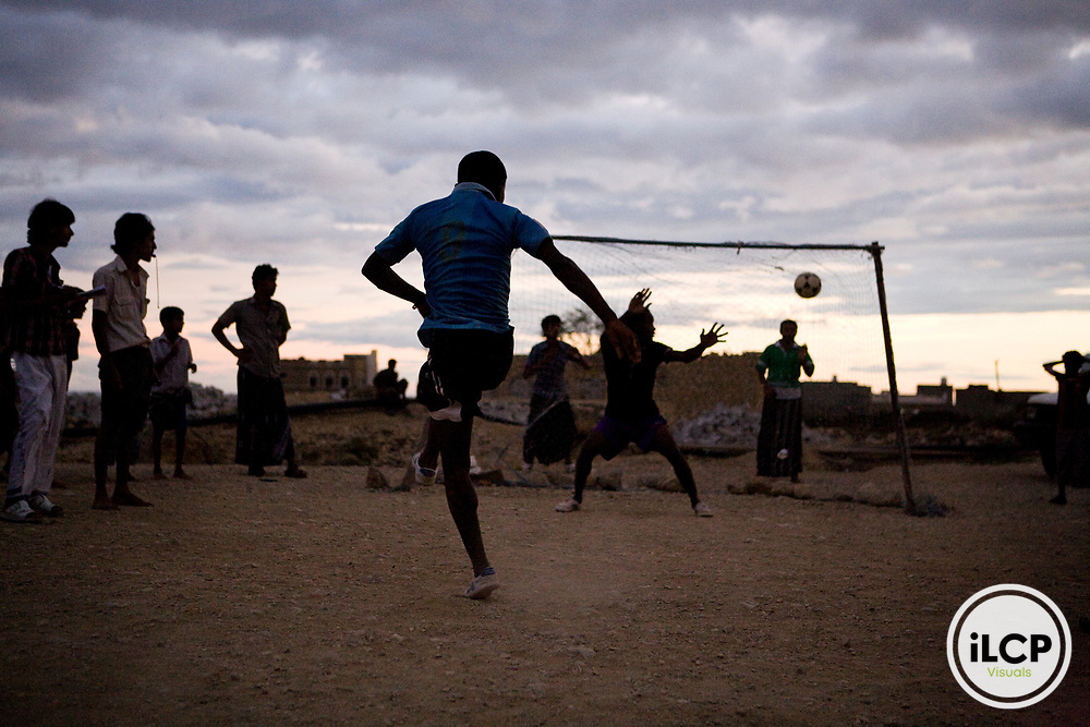 Penalty shootout in soccer game played on rock field, Hawf Protected Area, Yemen