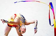 ROTTERDAM - Een deelneemster aan het NK Turnen in Rotterdam op het onderdeel Ritmisch Gymnastiek.