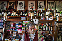 """AFFILE, ITALY - 23 AUGUST 2012: Luciano Battiglieri, 52, is the owner of Bar San Sebastiano where fascist Marshall Rodolfo Graziani is remembered in exposed books and postcards in Affile, a town with a population of 1,600 80km east of Rome, on August 23, 2012. A mausoleum and park, dedicated to the memory of Fascist Field Marshall Rodolfo Graziani, has recently been opened in the Italian town of Affile. At a cost of €127,000 to local taxpayers, the mayor Ercole Viri has expressed hope that the site will become as 'famous and as popular as Predappio' – the burial place of Mussolini which has become a shrine to neo-Fascists. Rodolfo Graziani was the youngest colonel in the Regio Esercito (Royal Italian Army), known as the """"Butcher of Fezzan"""" and the """"Butcher of Ethiopia"""" for the brutal military campaigns and gas attacks he led in Libya and Ethiopia under the dictatorship of Benito Mussolini under which he then became Minister of Defence from 1943 to 1945."""