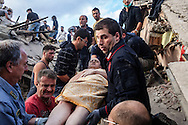 24 August 2016, Amatrice Italy - Rescue teams save a man after a 6.3 earthquake hit the town of Amatrice in Lazio region killing more than 240 people. Many other towns of the italian central regions have been hit by the quake. There are still many missing people under the rubble.