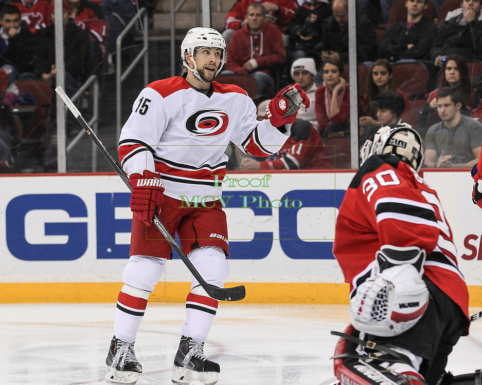 Carolina Hurricanes left wing Tuomo Ruutu (15) celebrates a 2nd period goal during the NHL regular season game between the New Jersey Devils and Carolina Hurricanes at Prudential Center in Newark, NJ.