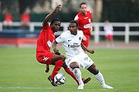 FOOTBALL - FRIENDLY GAMES 2010/2011 - PARIS SAINT GERMAIN v EVIAN THONON - 10/07/2010 - ERIC BRETAGNON / DPPI -  STEPHANE SESSEGNON (PSG) / ERIC TIEBI (EVIAN)
