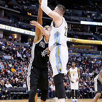 08 April 2016: Denver Nuggets center Jusuf Nurkic (23) goes for the baby hook over San Antonio Spurs center Tim Duncan (21) during the Denver Nuggets 102-98 victory over the San Antonio Spurs, at the Pepsi Center, Denver, Colorado, USA.