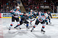 KELOWNA, CANADA - DECEMBER 30: Kyle Pow #21 of the Kelowna Rockets stick checks Kaid Oliver #34 of the Victoria Royals on December 30, 2017 at Prospera Place in Kelowna, British Columbia, Canada.  (Photo by Marissa Baecker/Shoot the Breeze)  *** Local Caption ***