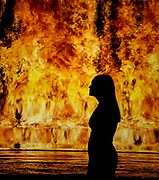 Bill Viola / Michelangelo: Life, Death, Rebirth exhibition opening - Works by Michelangelo ((1475 -1564) and pioneering video artist Bill Viola (b. 1951) at the Royal Academy of Arts, London, Great Britain  <br /> Press view <br /> 22nd January 2019<br /> <br /> Fire Woman - video , 2006 - Bill Viola <br />  <br /> Though working five centuries apart and in radically different media, these artists are both concerned with exploring the cycle of life.<br />  <br /> Bill Viola / Michelangelo: Life, Death, Rebirth is a unique opportunity to see major works from Viola&rsquo;s long career and some of the greatest drawings ever created by Michelangelo, together for the first time. It will be the first exhibition at the Royal Academy largely devoted to video art.<br />  <br /> Bill Viola / Michelangelo : Life, Death, Rebirth, Royal Academy of Arts, London runs from 26 January - 31 March 2019<br /> <br /> Photograph by Elliott Franks