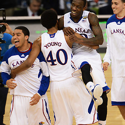 Mar 31, 2012; New Orleans, LA, USA; Kansas Jayhawks guard Tyshawn Taylor (10) and forward Kevin Young (4) celebrate after defeating the Ohio State Buckeyes 64-62 in the semifinals of the 2012 NCAA men's basketball Final Four at the Mercedes-Benz Superdome. Mandatory Credit: Derick E. Hingle-US PRESSWIRE