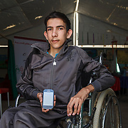 Muhammad, 18, says that the numbers on his phone are the most important thing that he brought with him from Syria. The numbers allow him to communicate with his friends and family who stayed behind.<br /> <br /> Muhammad has severe scoliosis, but is able to attend classes thanks to Mercy Corps&rsquo; inclusive education program. He learns and participates in activities in this Mercy Corps classroom in Zaatari camp for Syrian refugees, Jordan, May 2015.