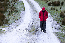 © Licensed to London News Pictures. 29/11/2017. Hawes UK. A man walks down a frost covered track near the village of Hawes in the Yorkshire Dales this morning as over night ice set on roads.  Photo credit: Andrew McCaren/LNP