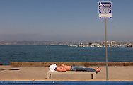 Napping on the Embarcadero in downtown San Diego, CA on Tuesday, July 27, 2004.