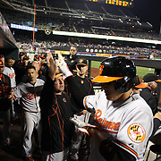 Manny Machado, Baltimore Orioles, celebrates a home run with his team mates in the dugout during the New York Mets Vs Baltimore Orioles MLB regular season baseball game at Citi Field, Queens, New York. USA. 5th May 2015. Photo Tim Clayton