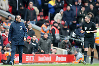 Football - 2018 / 2019 Premier League - Liverpool vs. Chelsea<br /> <br /> Chelsea Manager Maurizio Sarri and Referee Michael Oliver exchange words, at Anfield.<br /> <br /> COLORSPORT/PAUL GREENWOOD