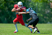 Calum Davidson (#21)  attempts to break a tackle during the BAFA Northern Division match between Edinburgh Wolves and Sheffield Giants at Meggetland Sports Complex, Edinburgh, Scotland on 1 July 2018. Picture by Malcolm Mackenzie.