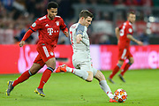 Liverpool midfielder James Milner (7) clears the ball away from the imminent danger of Bayern Munich midfielder Serge Gnabry (22) during the Champions League match between Bayern Munich and Liverpool at the Allianz Arena, Munich, Germany, on 13 March 2019.