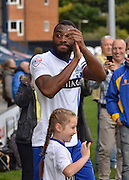 Bury Defender Nathan Cameron ap[plauds the fans as he leads out the mascots during the Sky Bet League 1 match between Bury and Rochdale at Gigg Lane, Bury, England on 17 October 2015. Photo by Mark Pollitt.