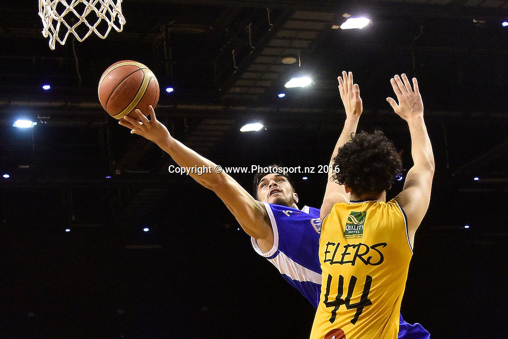 Saints' Shea Lli (Back) jumps to shoot with Moutainairs' Logan Elers during the NBL Wellington Saints vs Taranaki Mountainairs basketball match at the TSB Arena in Wellington on Friday the 29h of April 2016. Photo by Marty Melville / www.Photosport.nz