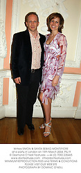 Writers SIMON & SANTA SEBAG-MONTEFIORE at a party in London on 15th March 2004.PSJ 9