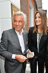 GIANCARLO GIAMETTI and ASTRID MUNOZ at the launch of the new collection from Limoland held at Anderson & Sheppard's Haberdashery, 17 Clifford Street,London on 16th June 2014.