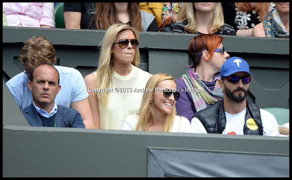 Sam Branson(L) and Jelena Ristic (bottom centre), the girlfriend of Novak Djokovic of Serbia watch his Gentlemen's Singles first round match on Centre Court against Florian Mayer of Germany on day two Of the Wimbledon Tennis Championships.<br /> Tuesday, 25th June 2013<br /> Picture by Andrew Parsons / i-Images