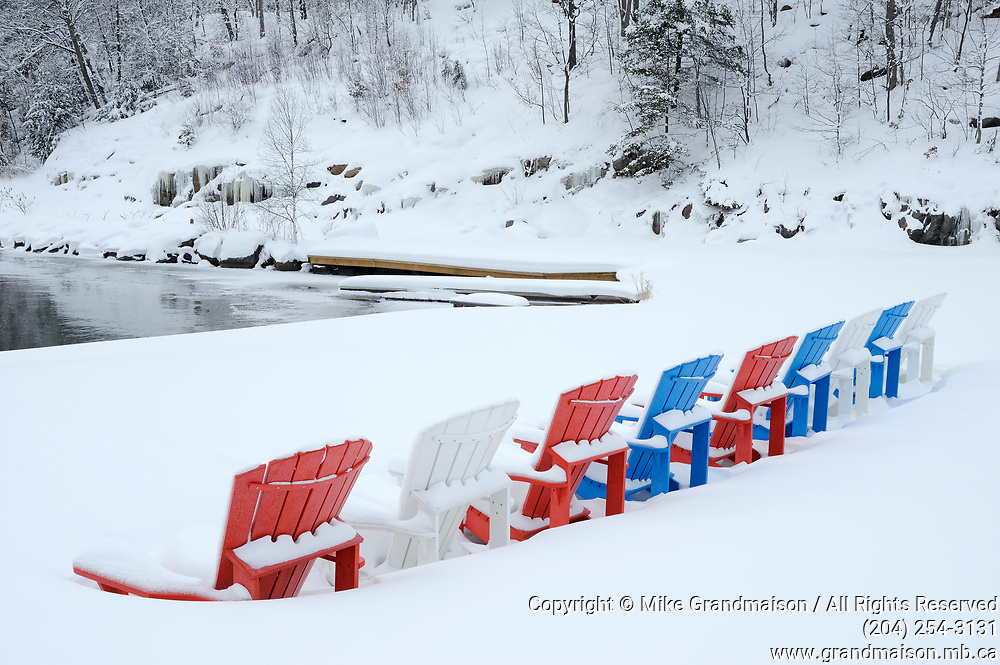 Muskoka chairs on Lake Muskoka in winter, Port Carling, Ontario, Canada<br />
