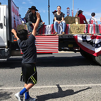 The Diiamd G Home Center float thrilled a young parade-goer during the Grants Fourth of July Parade Wednesday.