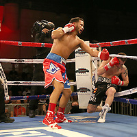 Jose Lopez (L) knocks down Daniel Lopez during a Telemundo boxing match between at Osceola Heritage Park on Friday, February 23, 2018 in Kissimmee, Florida.  (Alex Menendez via AP)