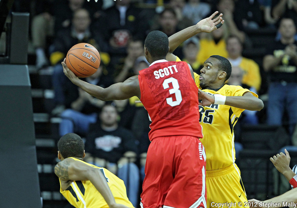 January 07, 2011: Ohio State Buckeyes guard Shannon Scott (3) puts up a shot as Iowa Hawkeyes forward Devon Archie (35) defends during the the NCAA basketball game between the Ohio State Buckeyes and the Iowa Hawkeyes at Carver-Hawkeye Arena in Iowa City, Iowa on Saturday, January 7, 2012.