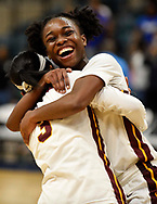 Summer Creek's Adaora Nwokeji, right, hugs teammate Mailyn Wilkerson after the team's win over Westside during triple overtime of a 6A regional championship basketball game, Saturday, Feb. 23, 2019, in Katy, TX. Summer Creek won the game in triple overtime, 72-63.
