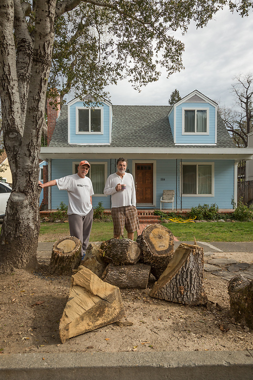 """We have one more tree to cut down...it has a giant split and could come crashing down any moment.""  Al Consilio and San Francisco school teacher Frank Kanios stand in front of the house they co-own on Myrtle Street in Calistoga"