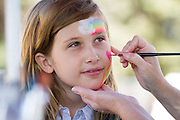 Kinsey Pietrasik, 10, gets her face painted at the Family Giving Tree booth during Relay For Life on June 23, 2012 at the Milpitas Sports Center.  Photo by Stan Olszewski/SOSKIphoto.