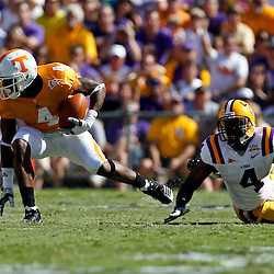 Oct 2, 2010; Baton Rouge, LA, USA; Tennessee Volunteers wide receiver Gerald Jones (4) runs away from LSU Tigers cornerback Jai Eugene (4) during the first half at Tiger Stadium.  Mandatory Credit: Derick E. Hingle