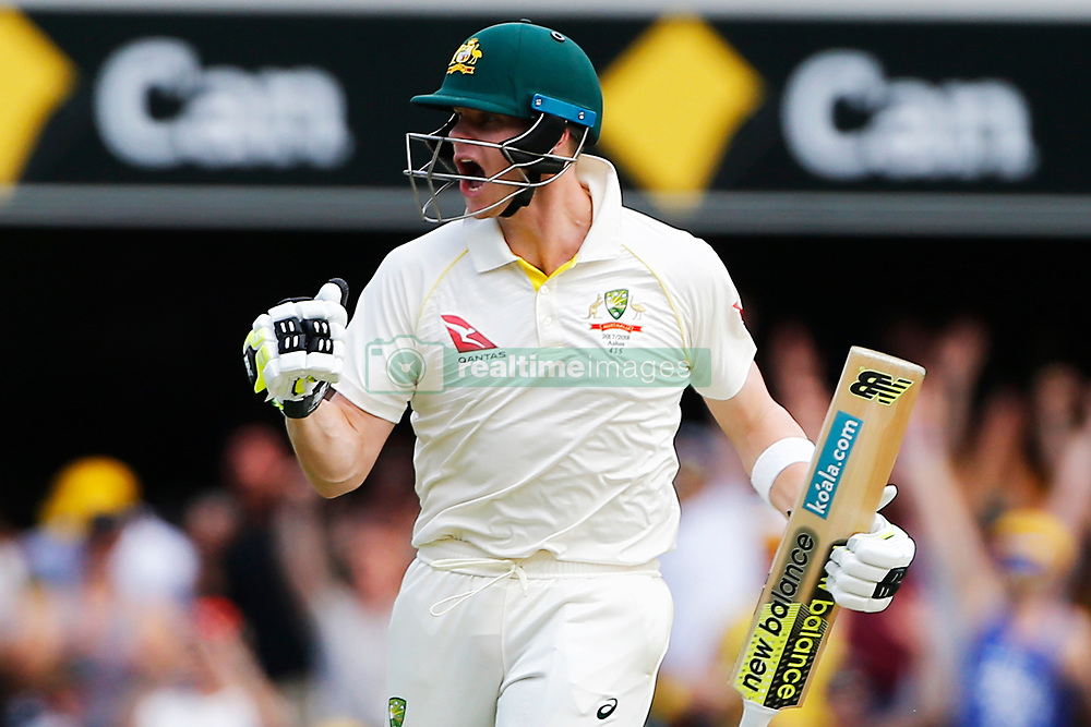 Australia's Steve Smith celebrates his century during day three of the Ashes Test match at The Gabba, Brisbane.